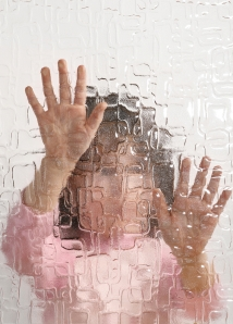 child trying to get through glass