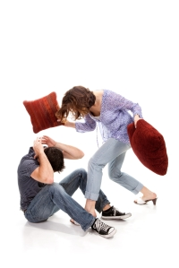 woman hitting man with pillows