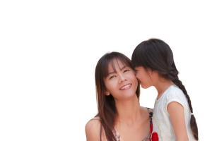 asian daughter kissing mom