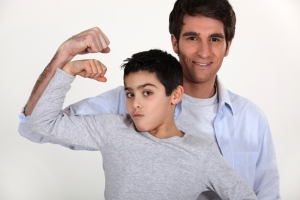 father son showing muscles