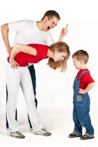 parents and young boy in intense conflict