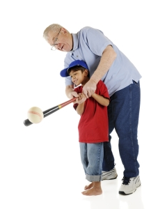 dad teaching boy baseball