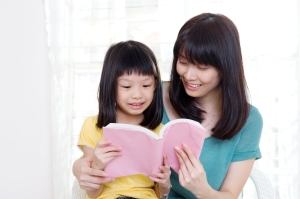 reading to kid, asian