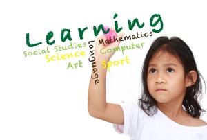 girl writing learning