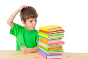 kid overwhelmed by books