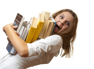 stressed student with books