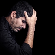 upset man, black background